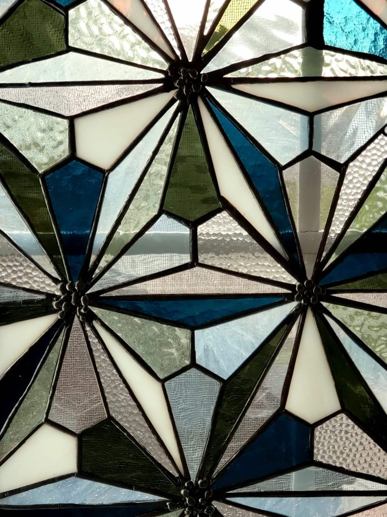 close up of flower star pattern stained glass panel